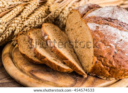 Freshly baked breads with grains  . - stock photo