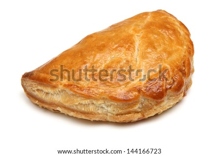 Freshly baked Cornish pastie on white background. - stock photo