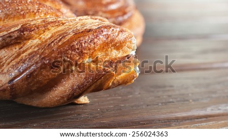 freshly baked croissant on the wooden table - stock photo