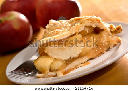 Freshly baked deep dish apple pie served on white plate. - stock photo