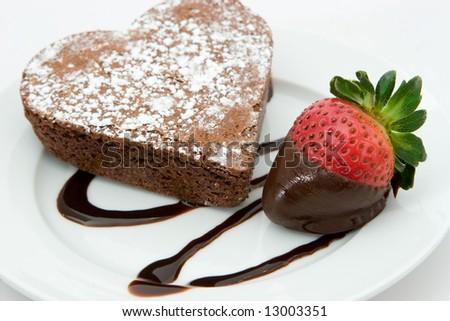 freshly baked heart cake and strawberry - stock photo