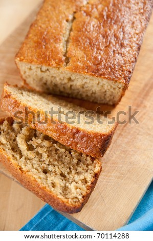Freshly Baked Loaf of Banana Bread Sliced for Sharing - stock photo