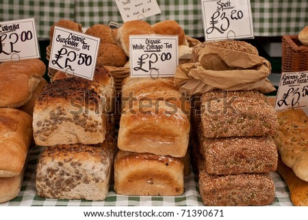 Freshly baked loaves of bread on a market stall - stock photo
