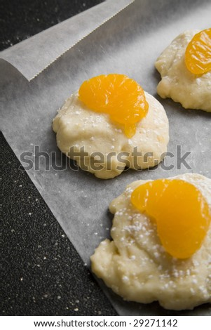 Freshly baked orange marmalade sugar cookies with a slice of mandarin orange on top. - stock photo