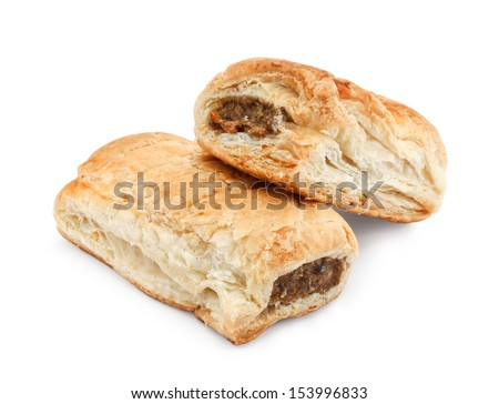 Freshly baked pair of sausage rolls isolated against a white background a traditional popular pastry snack available hot or cold at bakeries in the UK - stock photo