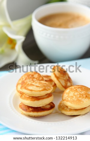 Freshly baked poffertjes - traditional Dutch little pancakes, selective focus - stock photo
