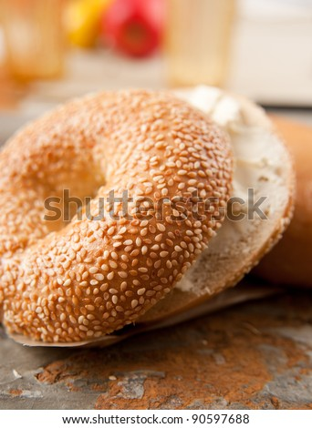 Freshly Baked Sesame Seed and Plain Bagels - stock photo