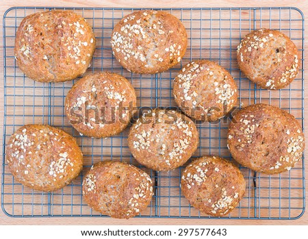 Freshly baked the whole grain bread rolls with oats, nuts and seeds. - stock photo