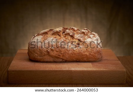 Freshly baked traditional bread on a table - stock photo