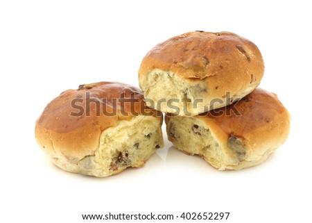 freshly baked traditional dutch raisin buns on a white background - stock photo