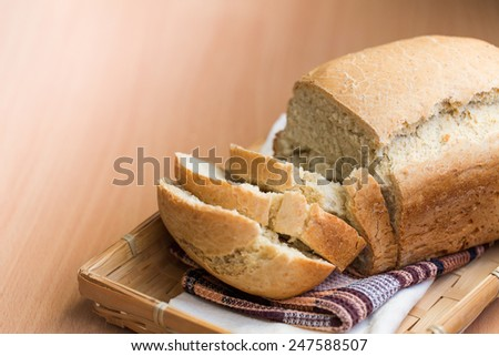 Freshly baked white bread on a wooden board - stock photo