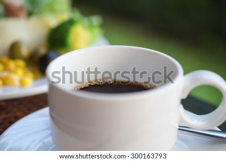 Freshly brewed black hot coffee and salad for morning breakfast background - stock photo