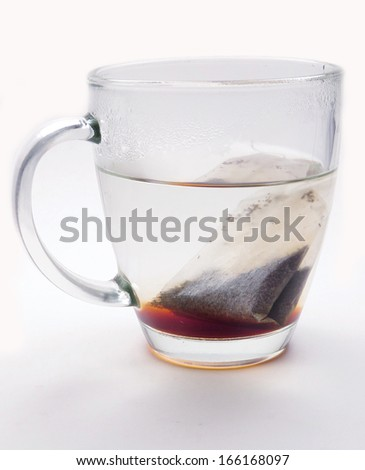 Freshly brewed tea with a tea bag in a glass mug - stock photo