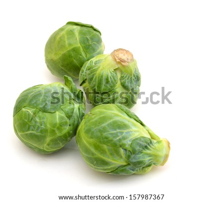 freshly brussel sprouts and some whole ones on a white background  - stock photo