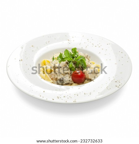 Freshly cooked pasta with mushrooms, basil, cheese and spices on a plate on a white background. - stock photo