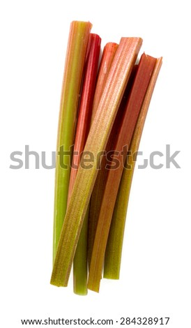 freshly cut stems of rhubarb isolated on white background - stock photo