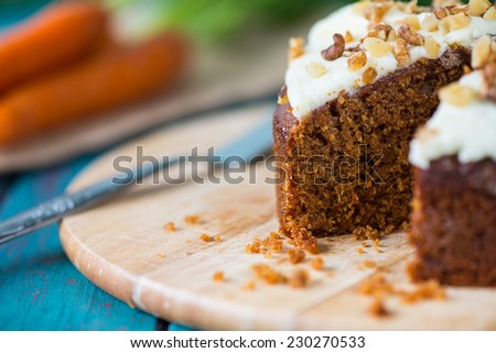 Freshly decorated organic carrot cake - stock photo