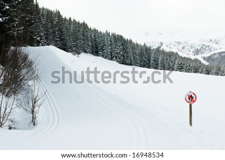 Freshly groomed empty cross-country ski track at French Alps - stock photo