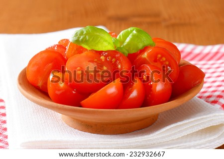 freshly halved cherry tomatoes as a healthy snack - stock photo