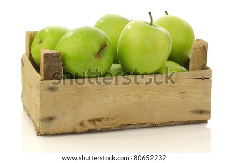 """freshly harvested """"Granny Smith"""" apples in a wooden crate on a white background - stock photo"""