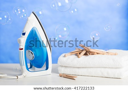 Freshly laundered towels with pegs and floating bubbles - stock photo