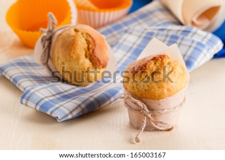 Freshly made muffins on kitchen table - stock photo