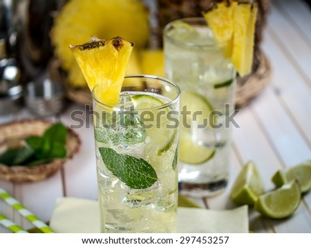 Freshly made pineapple mojito with ingredients setting - stock photo