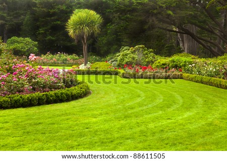 Freshly mowed lawn in a formal garden. - stock photo