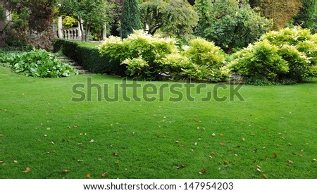 Freshly Mown Lawn in a Peaceful Garden - stock photo