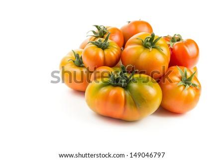 Freshly picked organic tomatoes - stock photo