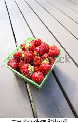 Freshly Picked Strawberries in a Green Plastic Basket - stock photo