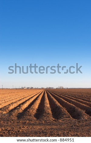 Freshly plowed farmland - stock photo