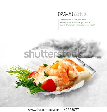 Freshly prepared classic Prawn Cocktail served in a scallop shell placed on white snow.  - stock photo