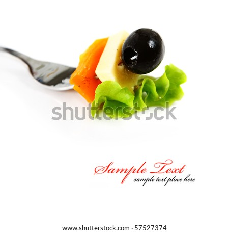 Freshly prepared salad served on a fork - stock photo