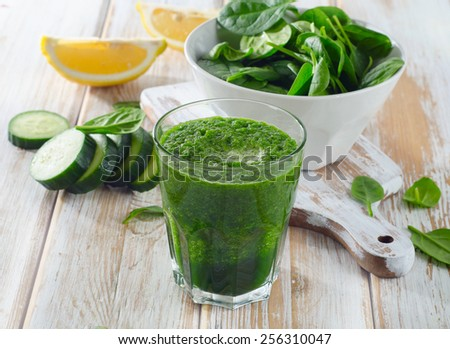Freshly Squeezed Vegetable Juice  on a wooden board. - stock photo