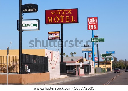 FRESNO, UNITED STATES - APRIL 12, 2014: Motel row in Fresno, California. There are about 150 motels in Fresno, the 5th largest city in California. - stock photo