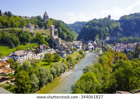 FRIBOURG, SWITZERLAND - SEPTEMBER 10, 2015: Landscape of green areas of the city, located on both sides of the river Sarine which shares two linguistic regions between German and French cultures - stock photo