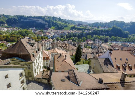 FRIBOURG, SWITZERLAND - SEPTEMBER 10, 2015: The capital city of the canton of Fribourg, located on both sides of the river Sarine which shares two linguistic regions between German and French cultures - stock photo