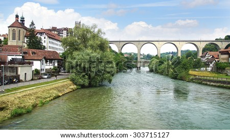 FRIBURG, SWITZERLAND - JUNE 16, 2015: Zaehringen bridge crossing the Sarine at Medieval town. The Zaehringen Bridge is arched double deck bridge was built in 1924.  - stock photo