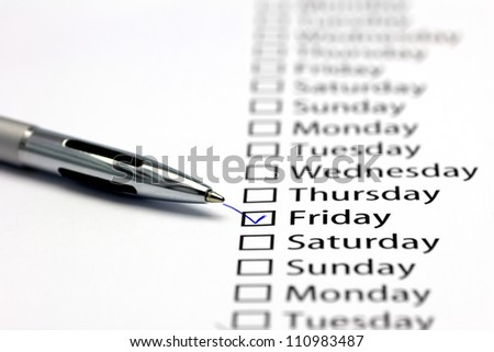Friday checked in check box in a row of days of the week - stock photo