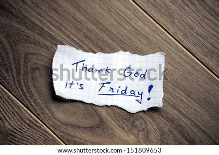 Friday message written on piece of paper, on a wood background. - stock photo