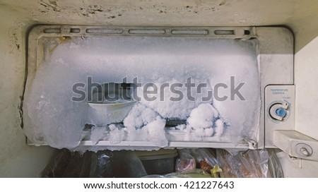 Fridge freezer filled with ice.Show for dirty and used film filter. - stock photo