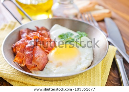 fried bacon and eggs - stock photo