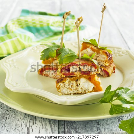 Fried battered stuffed sweet peppers with fillet of fish - stock photo