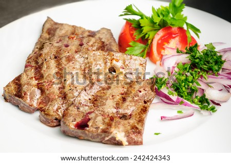 fried beef liver with vegetables - stock photo