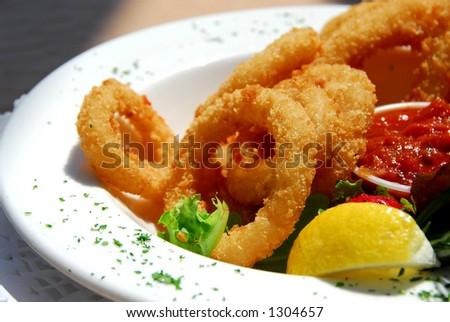 Fried calamari with sauce - stock photo