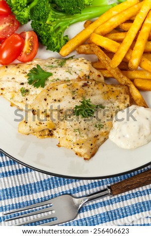 Fried Catfish fillet with vegetables. Selective focus. - stock photo