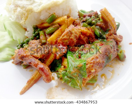 Fried catfish in spicy curry sauce on white dish, Spicy Stir Fried Fish. Thai food - stock photo