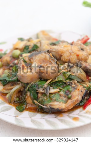 Fried catfish Spicy thailand food.Selective focus. Very shallow Depth of Field, for soft background. - stock photo