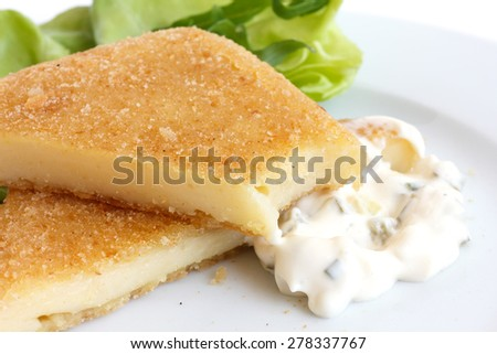 Fried cheese, cut, melting, tartar sauce, salad. Bite. - stock photo